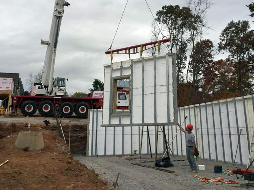 precast walls being lowered into place